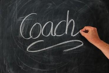 """Mot """"coach"""" écrit sur un tableau"""